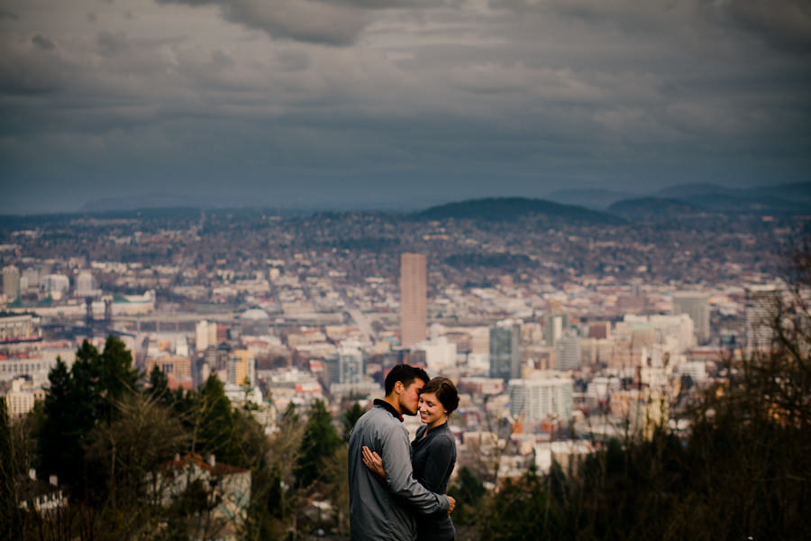 Wedding couple pose for a photograph at Pittock Mansion