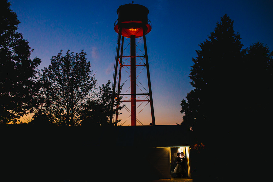 McMenamins Edgefield water tower in the backdrop of a beautiful wedding photo by Daniel Stark Photography