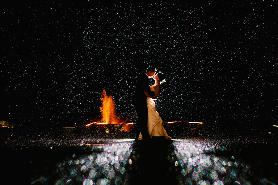 Wedding couple in the rain at Zenith Vineyard photographed by Daniel Stark