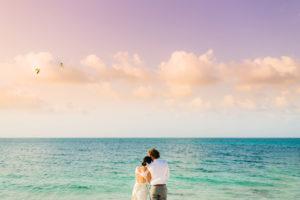 A bride and groom enjoying the sunset at Mother's House in Turks and Caicos.