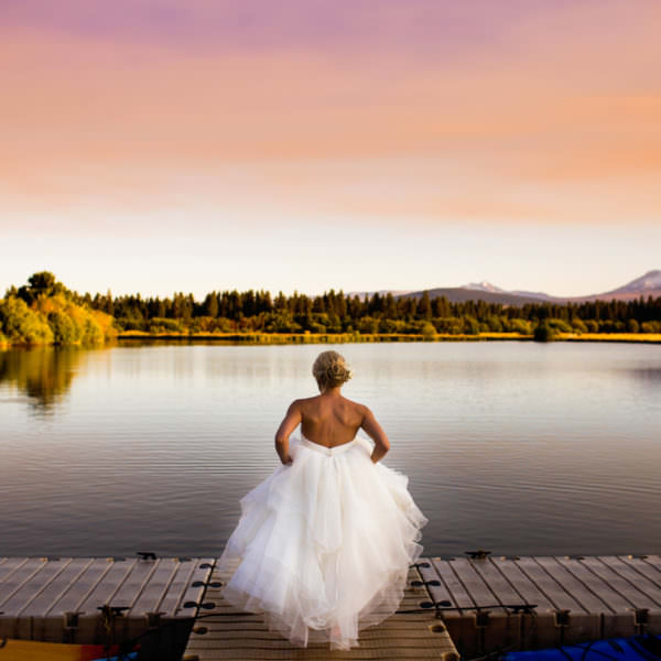 Beauitful bride walking on a dock at Black Butte Ranch Wedding in Sisters, Oregon.