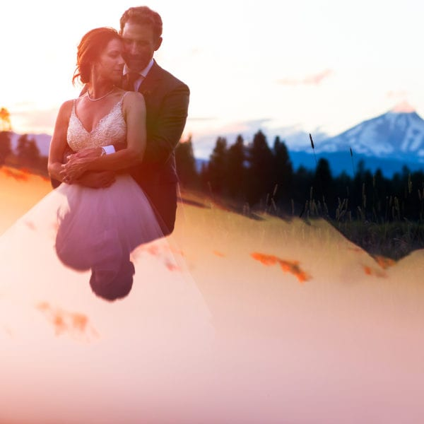 Bride and groom at sunset in front of Mt. Jefferson