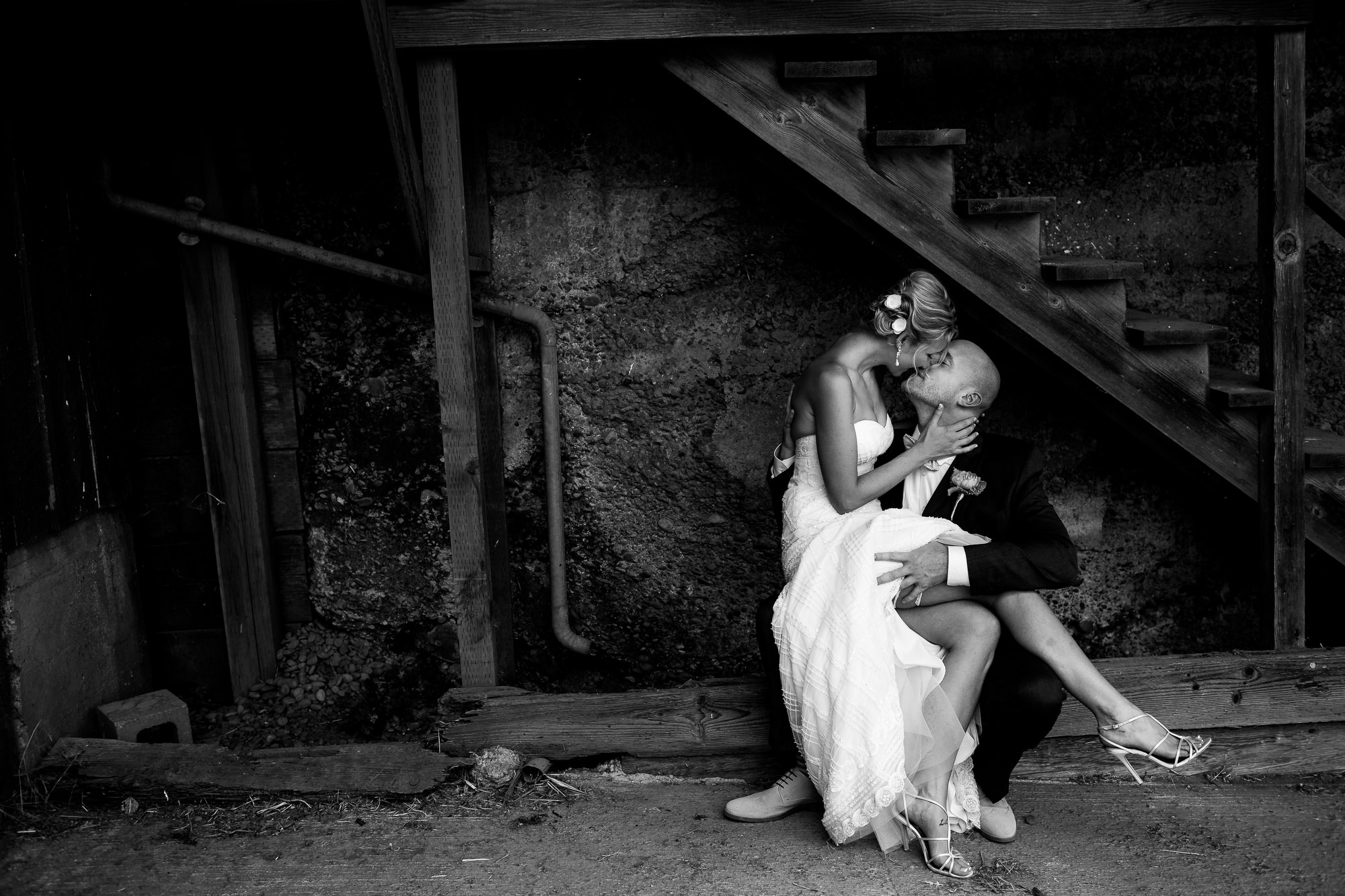 A Portland Oregon Bride and Groom kissing after their wedding ceremony.