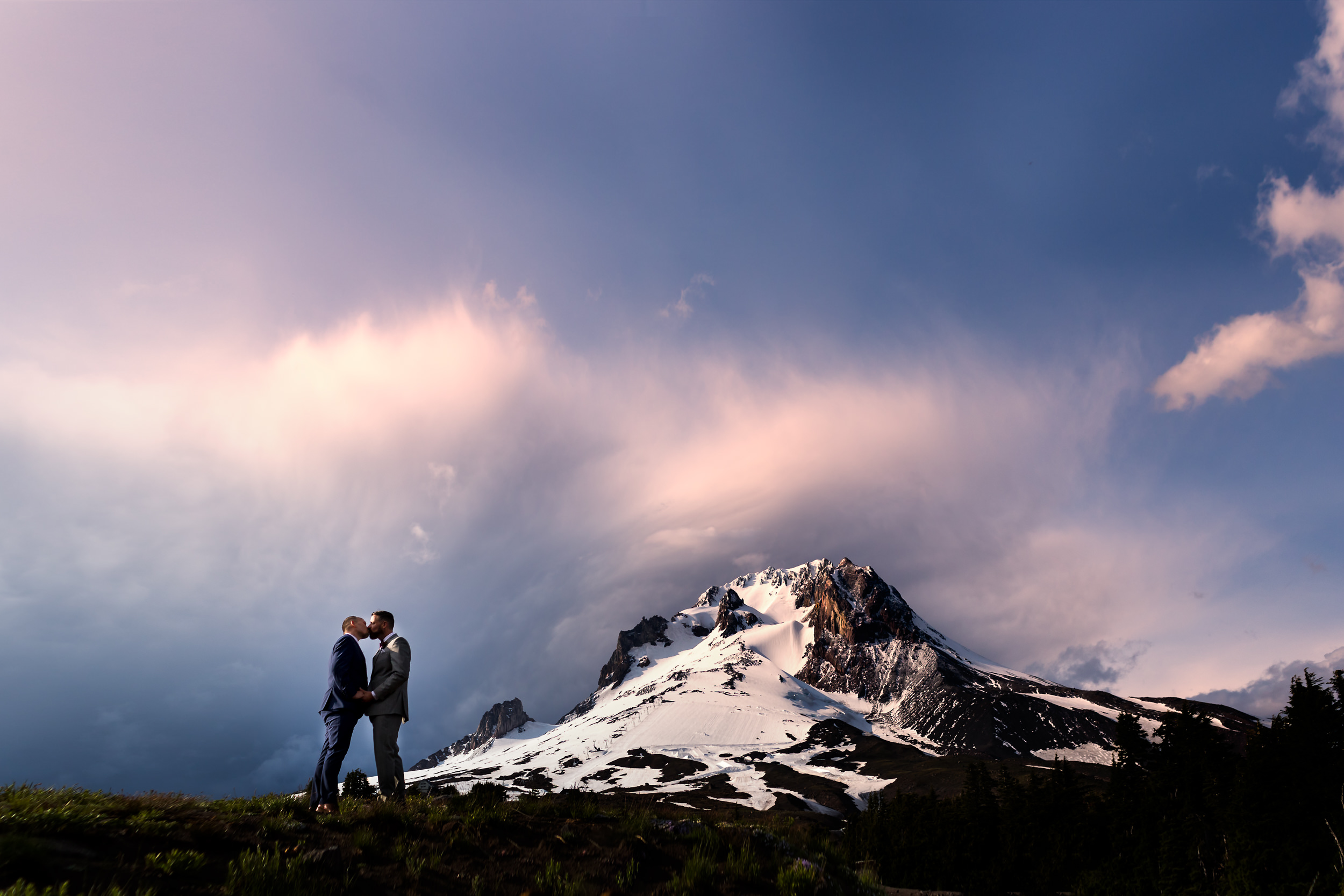 Just married grooms kiss with Mt. Hood as a backdrop